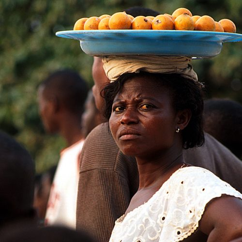 African Lady Selling Oranges