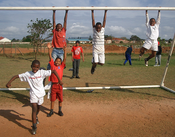 Kids Swing from Football Goal Posts